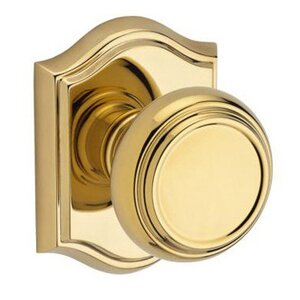 Baldwin Reserve - Single Dummy Traditional Door Knob with Traditional Arch Rose in Polished Brass
